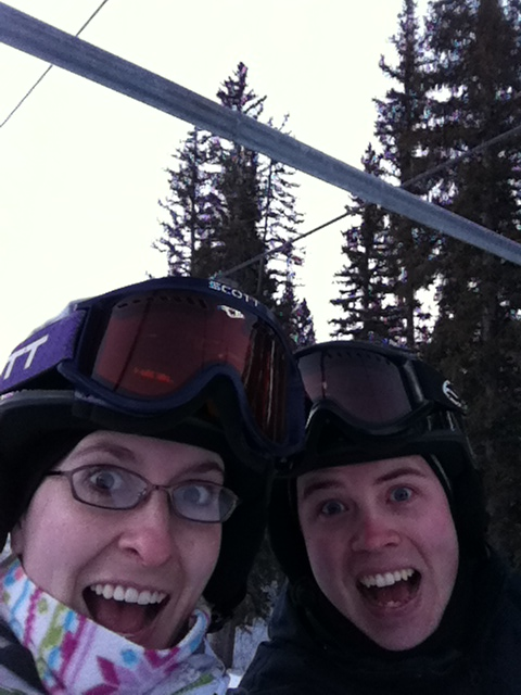 Riding the lift while snowboarding
