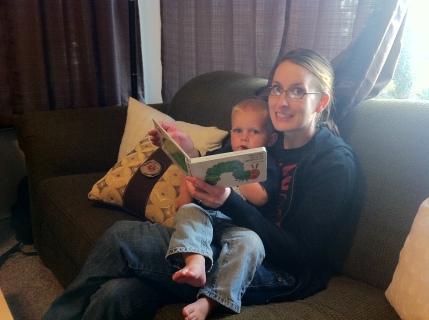 Andrea reading books while babysitting