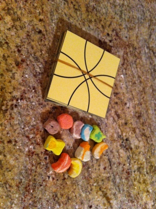 A game that Jake made for less than $1. Gotta love using Lucky Charm marshmallows as game pieces!