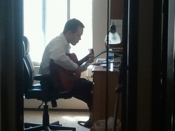 Jake tinkering on the guitar. Music has always been a big part of his life.