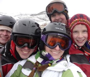 This us snowboarding with Andrea's Dad and two brothers. We love the thrill of getting up on the mountain in the beautiful snow!